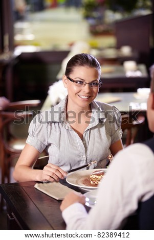 Young attractive couple in a restaurant - stock photo
