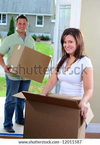 Young Attractive Couple Moving Into Their New Home - stock photo
