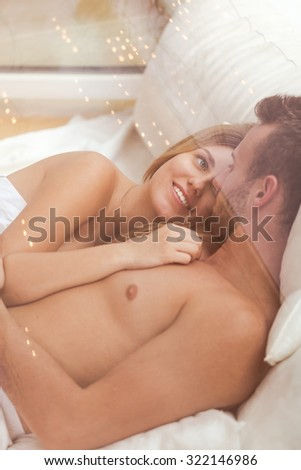 Young attractive couple relaxing after pleasant sex - stock photo
