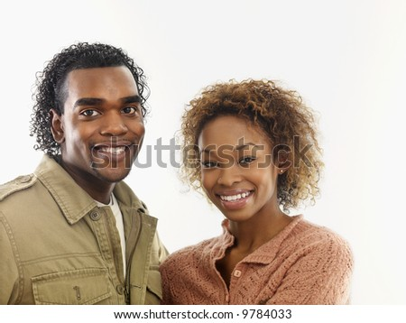 Young attractive couple smiling.