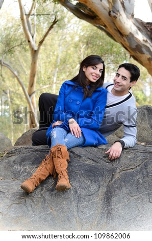Young attractive couple who are in love spending a happy day together in the park in winter