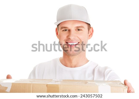 Young attractive courier guy delivering brown boxed parcel - stock photo