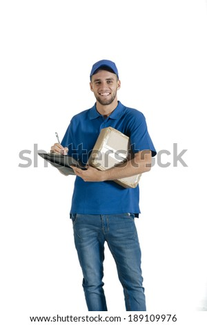 Young attractive courier guy holding parcel for delivery - stock photo
