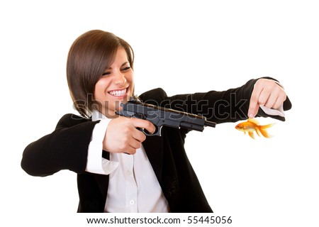 young attractive dangerous woman aiming at gold fish