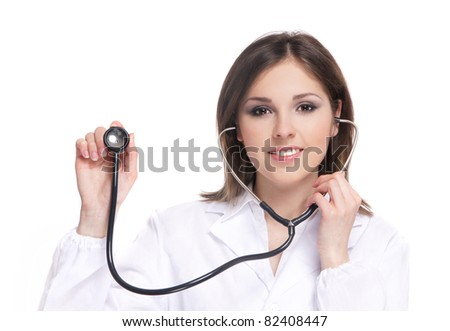 Young attractive doctor isolated over white background - stock photo
