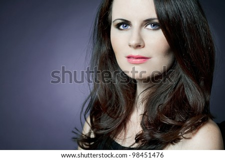 Young attractive fashion female model with long curly hair. - stock photo