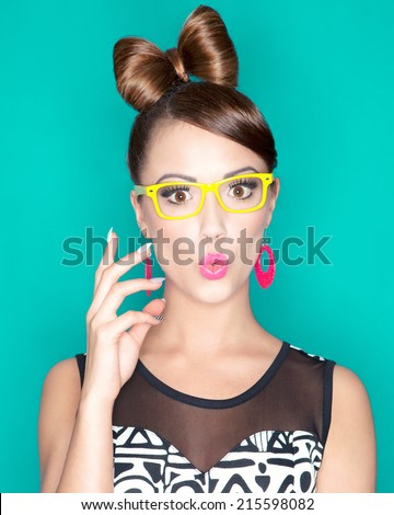 Young attractive fashionable surprised woman wearing glasses - stock photo