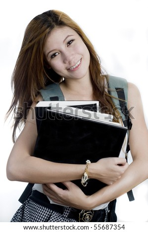 Young attractive female Asian student holding her school books - stock photo