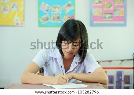Young attractive female Asian student sitting - stock photo