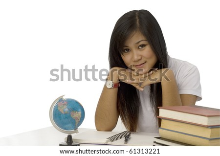 Young attractive female Asian student with her school books - stock photo