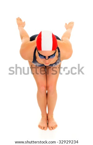 Young attractive female athlete, swimmer with goggles and swimming cap.  Studio shot. - stock photo