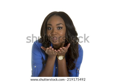 Young attractive female blowing kisses to the camera - stock photo