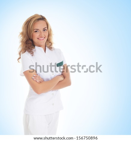 Young attractive female doctor isolated over blue background - stock photo