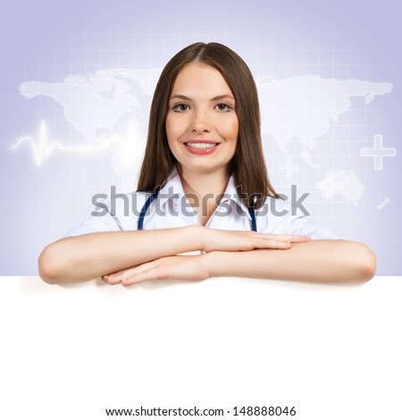 Young attractive female doctor put her hands on the blank banner, place for text - stock photo