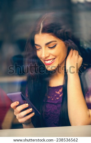 Young Attractive Female In Cafe Using Smart Phone - stock photo