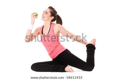 young attractive female in fitness outfit eats green apple, studio shoot isolated on white - stock photo