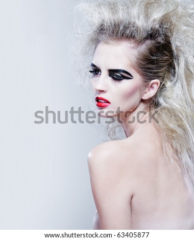Young attractive female model with long curly hair. - stock photo
