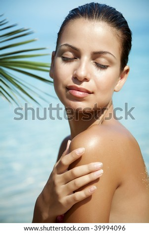 young attractive female on the beach, enjoying the sun - stock photo