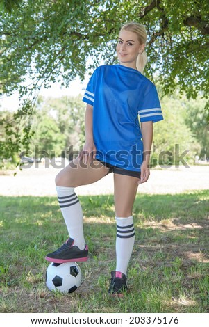 young attractive female soccer player - stock photo