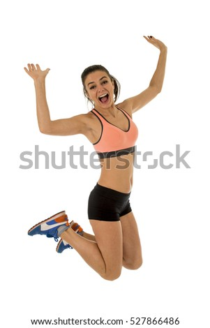 young attractive fitness trainer woman jumping high excited and happy wearing sport clothes isolated on white background in healthy lifestyle and body energy concept
