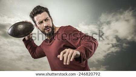 Young attractive football player playing with ball on sky background - stock photo
