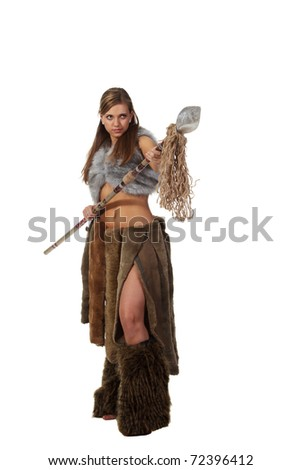 Young attractive girl in costume of savage woman attack by a spear - stock photo
