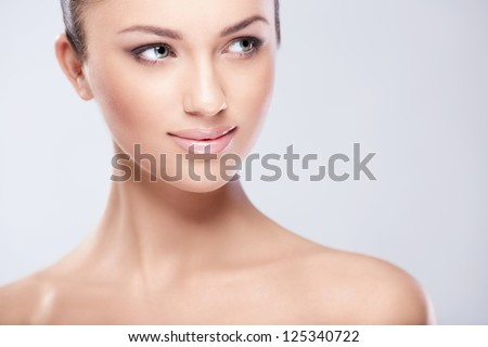 Young attractive girl in studio - stock photo