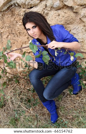 Young attractive girl in stylish clothers outdoors