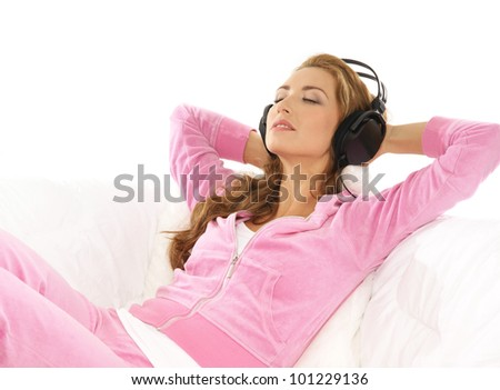 Young attractive girl listening to the music in modern interior - stock photo