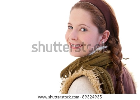 Young attractive girl looking back to camera, smiling.? - stock photo