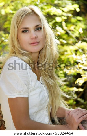 young attractive girl on natural background - stock photo