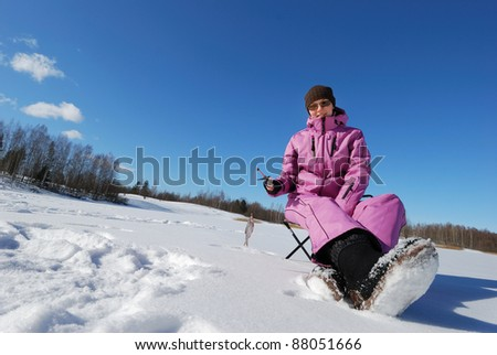Young attractive girl on winter fishing - stock photo