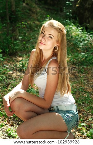 Young attractive girl outdoors - stock photo