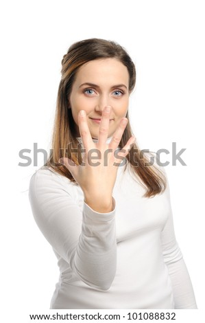 Young attractive girl shows gesture of the figure five. Isolated on white. - stock photo