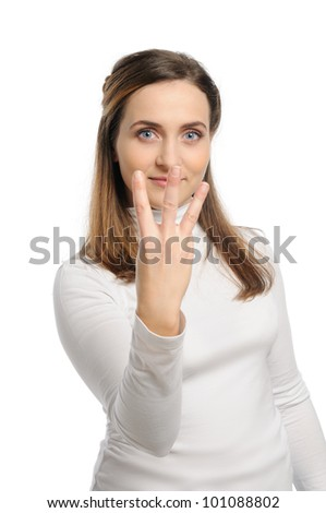 Young attractive girl shows gesture of the figure three. Isolated on white. - stock photo