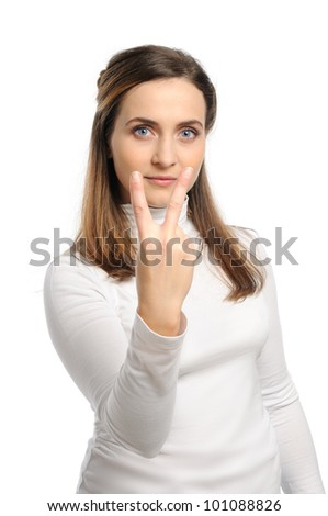 Young attractive girl shows gesture of the figure two. Isolated on white. - stock photo