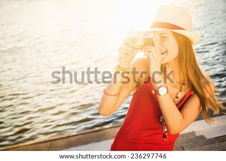 Young attractive girl with camera - stock photo