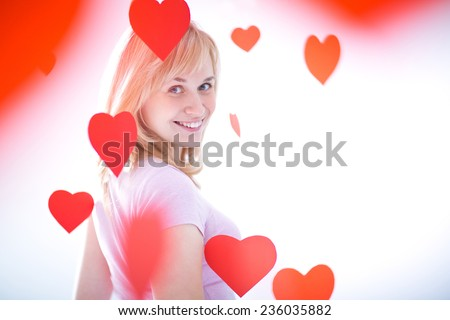 Young attractive girl with hearts - stock photo