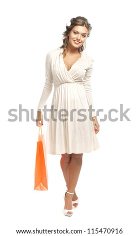 Young attractive girl with the shopping bag isolated on white - stock photo