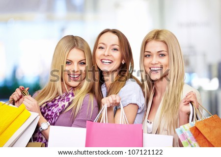 Young attractive girls in the shop - stock photo