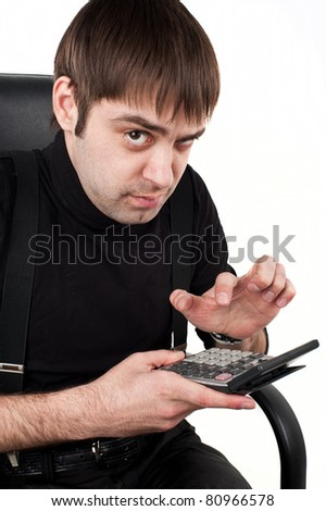 young attractive guy in the black businessman Caucasian  sits on a black leather chair and holding a  cost accountant ,the calculator shows the camera and performs calculations.isolated over white - stock photo