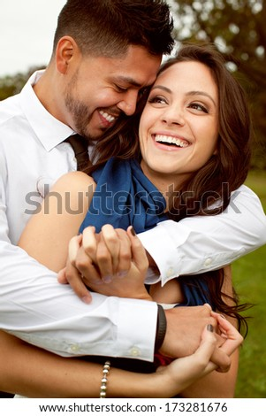 Young attractive happy couple in love posing outdoor. - stock photo