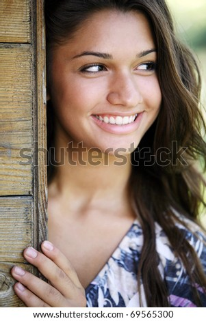 Young attractive happy girl posing outdoor. - stock photo
