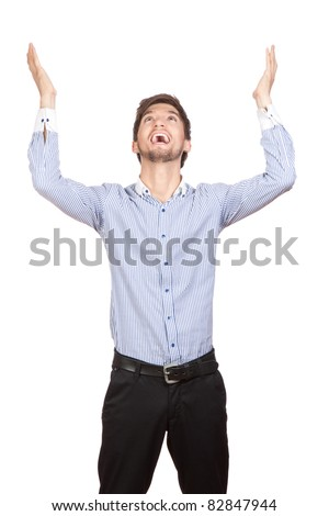 Young attractive happy smile business man stand and expressing success and victory concept, holding raised arms and hands up, isolated over white background