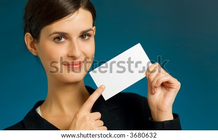 Young attractive happy smiling successful business lady with blank sign or business card - stock photo