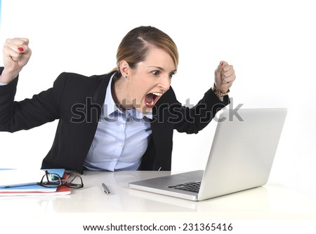 young attractive hectic businesswoman excited working at computer laptop on desk at work office in crazy happy face expression reading career promotion email isolated on white