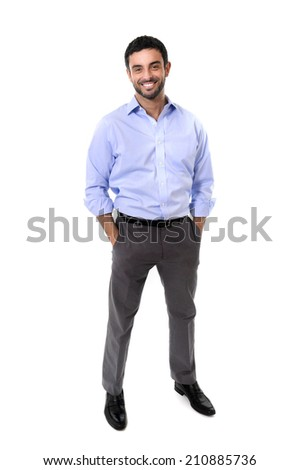 young attractive latin or spanish business man standing full body smiling happy in corporate portrait isolated on white background smiling with hands in pockets wearing shirt and suit trousers - stock photo