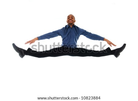 young attractive male dancer doing the splits - stock photo