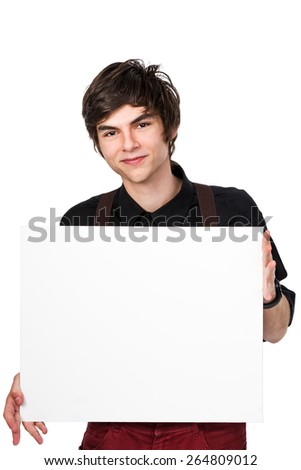 Young attractive male in a black shirt and red jeans with suspenders, holding a white sign with a confident and positive expression on his face, isolated on white - stock photo