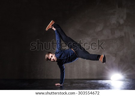 Young attractive man dancing